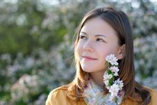 Young Woman In Blooming Park Royalty Free Stock Image
