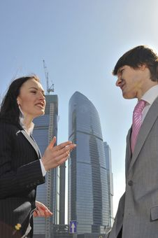 Free Two Businessmen Discuss The Project Against A Skys Stock Photo - 14006280