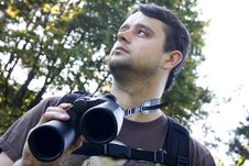 Free Young Bird Watcher Holding Binoculars Stock Image - 14006821