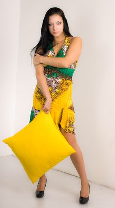 Free Girl With A Yellow Pillow Royalty Free Stock Images - 14008009