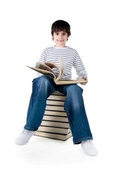 Free Cute Little Boy Sit On A Stack Of Big Books Royalty Free Stock Photography - 14008857