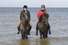 Free Two Amazones On Horseback On The Beach Stock Image - 14009551