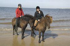 Free Two Amazones On Horseback On The Beach Stock Photos - 14009633