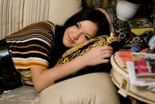 Free Girl Lying On The Couch Royalty Free Stock Photos - 14009978