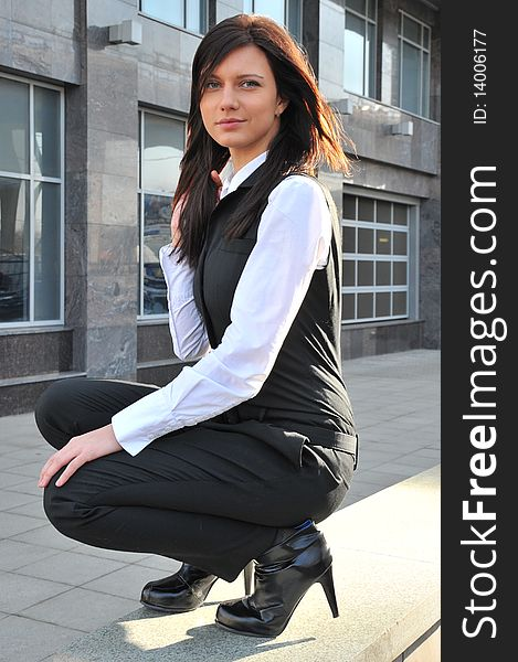 The business woman sits nearby centre business in