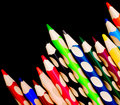 Free Colored Crayons Over Black Backround Stock Image - 14019991