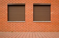 Wall From A Red Brick And By Windows Stock Photography