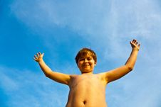 Free Young Boy Rises His Arms At The Beach Royalty Free Stock Image - 14014756