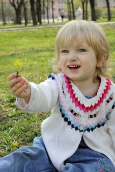 A Little Girl Gives A Flower Stock Image