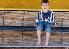 Free Smiling Boy Sitting In Beach Bar Stock Photography - 14014942