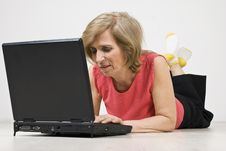 Senior Woman Relaxing And Using Laptop Royalty Free Stock Images