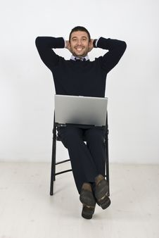 Free Happy Businessman With Laptop On Chair Stock Photo - 14018340