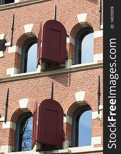 Historic dutch facade, windows with shutters