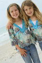 Free Happy Sisters On The Beach Royalty Free Stock Image - 14024646
