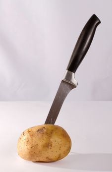 Free Knife In Potato Stock Image - 14020851