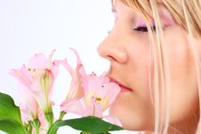 Free Portrait Of A Woman Holding Pink Flowers Royalty Free Stock Photos - 14023398