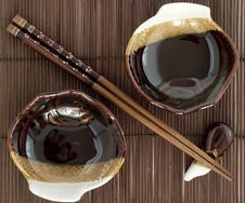 Free Sticks Fo Sushi And Two Plates On The Mat Royalty Free Stock Images - 14025079