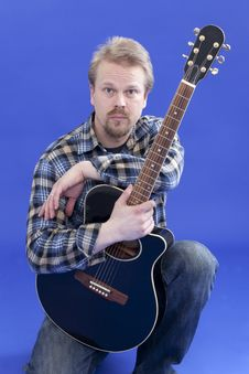 Portrait Of A Man With Guitar Stock Photography