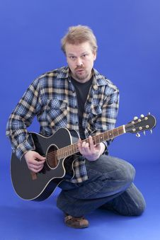 Portrait Of A Man With Guitar Stock Photo