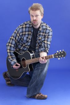 Free Man Posing With Guitar Royalty Free Stock Image - 14026506