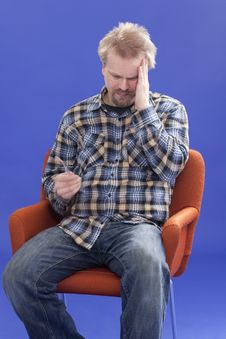 Free Tired Man Sitting On A Chair Stock Photography - 14026552