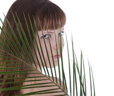Free Woman Hiding Behind The Palm Leaf Royalty Free Stock Photos - 14027818