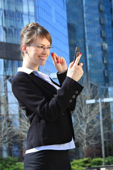 Free Smiling Businesswoman With A Mobile Phone Stock Photography - 14028012