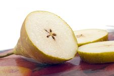Free Pear On A Glass Cutting Board Stock Image - 14031041