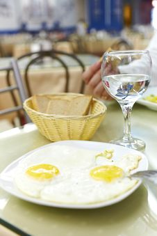 Fried Eggs Fried Eggs And A Glass Of Water Stock Image