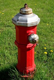 Fire Hydrant On Grass Royalty Free Stock Photos