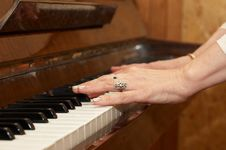 A Caucasian Woman S Hand Playing Piano Stock Photos