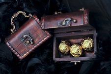 Free Three Sweets In Small Open Treasure Chest Royalty Free Stock Photos - 14038548