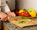Free Cook Chopped Onion On A Wooden Board Stock Photography - 14042932