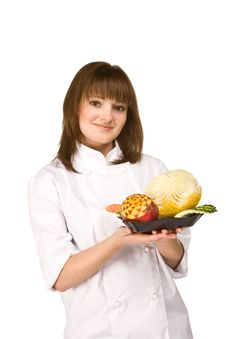 Free Cook Girl Holding A Plate Of Fruit Royalty Free Stock Photos - 14040098