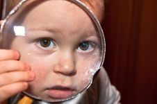 Young Baby Boy And Magnifying Glass Royalty Free Stock Photography