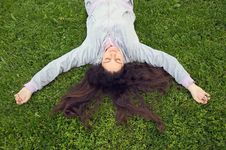 Free Pretty Girl Lying On The Grass Royalty Free Stock Photography - 14040587