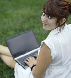 Young Woman Working On A Laptop Stock Photos