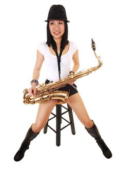 Chinese Girl Playing The Saxophone. Royalty Free Stock Photos