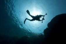 Silhouette Of An Underwater Photographer Royalty Free Stock Photo