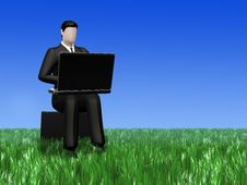 Businessman Working On  Laptop In The Field Grass Royalty Free Stock Photography