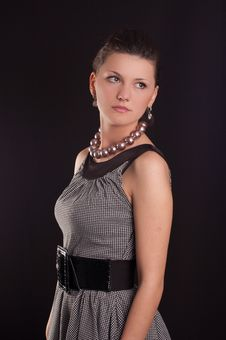 Girl With Beads In A Dress Stock Photos