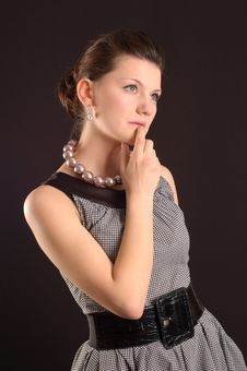 Girl With Beads In A Dress Royalty Free Stock Photos