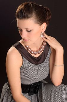 Girl With Beads In A Dress Royalty Free Stock Image