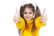 Free Young Girl Showing Her Thumbs Up Stock Photos - 14045223
