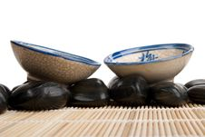 Free Two Cups And Stones On Mat Royalty Free Stock Images - 14048339