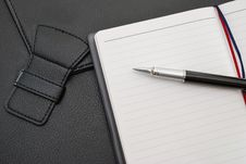 Free Black Pen On Blank Notepad With Suitcase Stock Photography - 14049182