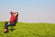Free The Girl On A Chair Royalty Free Stock Photography - 14049677