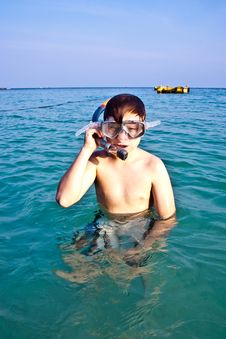 Young Boy Enjoying Snorkeling In The Sea