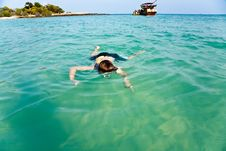 Free Young Boy Enjoying Snorkeling In The Sea Royalty Free Stock Image - 14049976