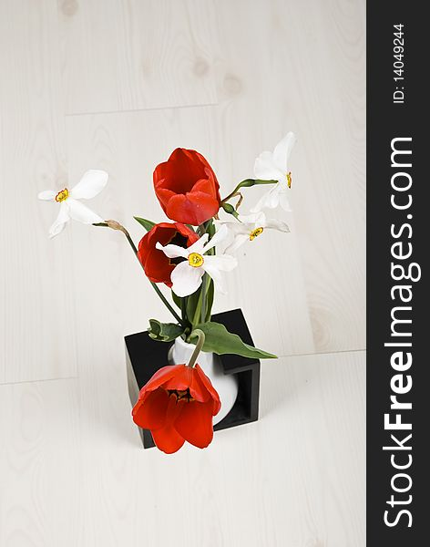 Top view of spring flowers in a vase